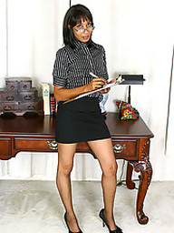 Adult ebony secretary slowly strips all..